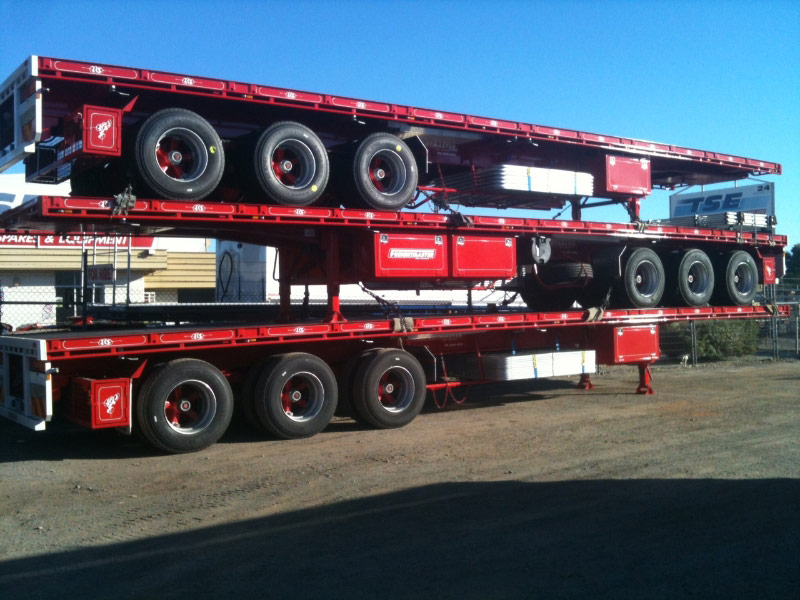 Stack of truck trailers with auto electrics installed by Class 1 Auto Electrics